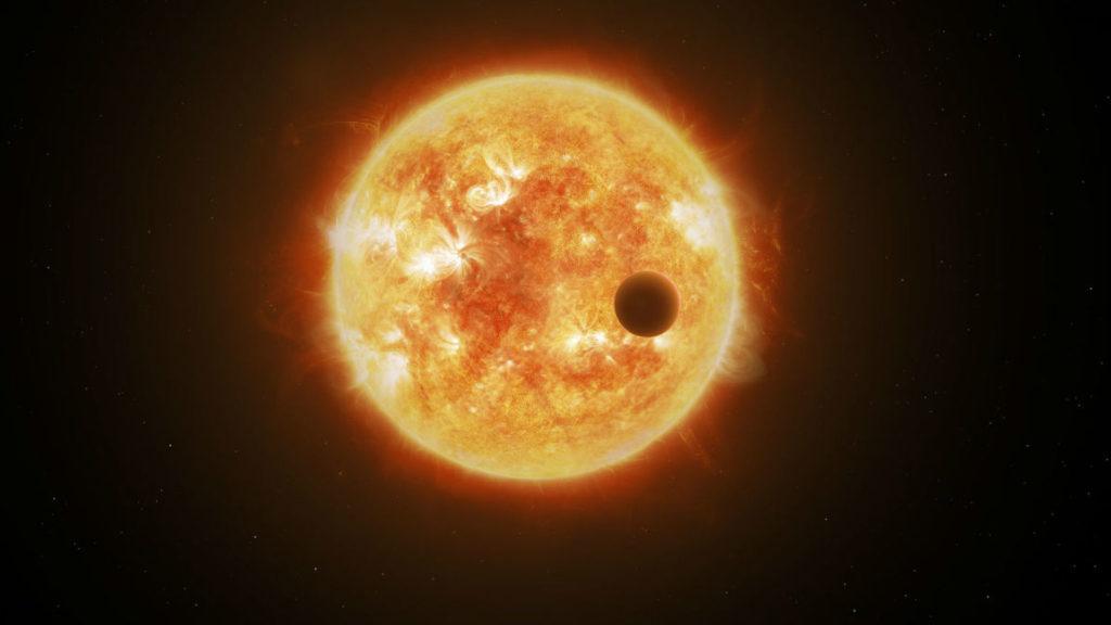 Силуэт планеты TOI 1338 b на фоне звезд, вокруг которых она вращается Chris Smith / Goddard Space Flight Center / NASA